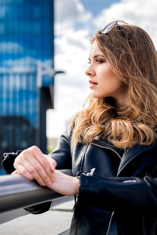 Woman thinking about future near office buildings